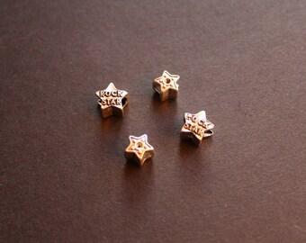 4 lampwork style beads Tibetan Silver Star