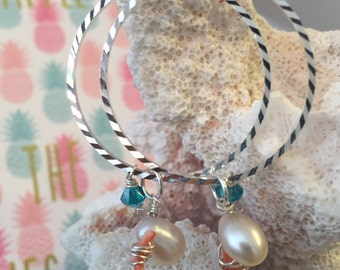 Silver hoop dangle earrings with pearls, coral and crystals.