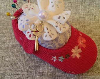 Red baby shoe pin cushion