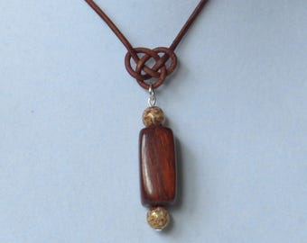 E-1839 Natural wood and glass bead pendant on brown leather cord