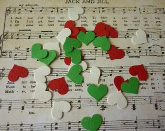 Set of 50 punch Christmas heart embellishments.