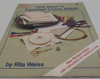 The First Steps in Cross Stitch Cross Stitch Patterns Basic Instructions with over 15 Charted Designs, By American School Of Needle Work