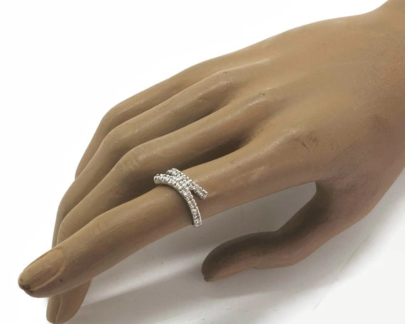 9 carat white gold diamond ring with cross over band, 20 small diamonds, very sparkly, stamped 375 for 9 carat gold, size L.5 / 6