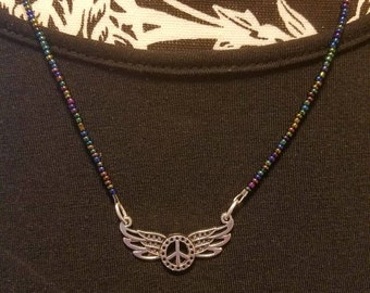 Peace sign necklace with angel wings