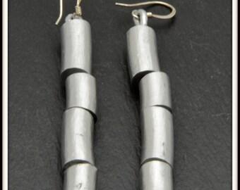 Pending aluminum earrings