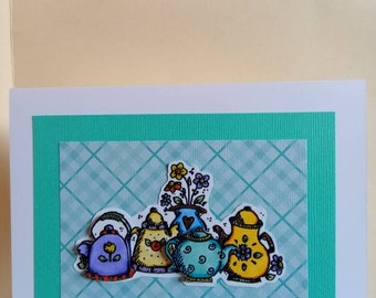 Teapots with a teal background