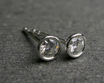 Bezel set round brilliant cut Moissanite and sterling silver stud earrings 4mm .50 carat tw