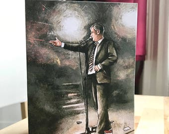 Tim Key shoots the flame off a candle card
