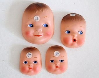 Vintage plastic moulded doll faces x4 in different sizes