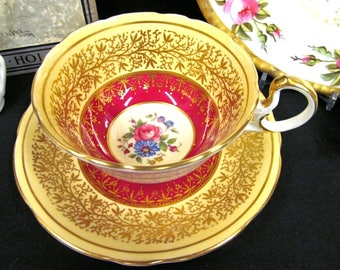 Aynsley Tea cup and saucer red & yellow rose center teacup with gold gilt low doris shape