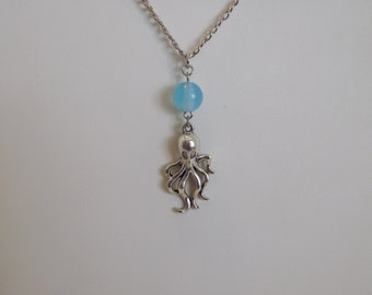 Silver octopus with light blue agate bead / 16 inch silver necklace.