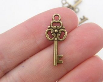 12 Key charms antique bronze tone K64