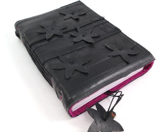 Journal with hand cut spring flowers, recycled bicycle inner tube, handmade blank, medium. Velcro closure,pink linen.