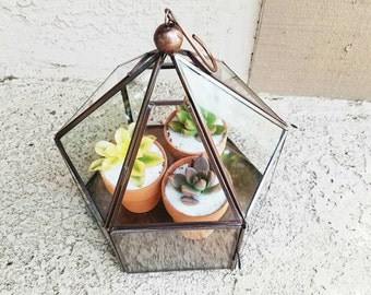 Bronze pentagon shape plant stand display keepsakes display