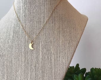 Gold plated crescent pendant