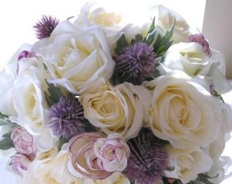 A Silk Scottish Brides bouquet of Ivory Rose's, Thistles and Ranunculus. Keepsake Bouquet. Matching Bridesmaids.