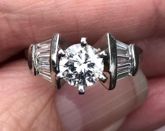 heavy...appraised 1 carat Diamond center --with .80 points of baguettes diamonds 1.80 carats  engagment ring in  Platinum