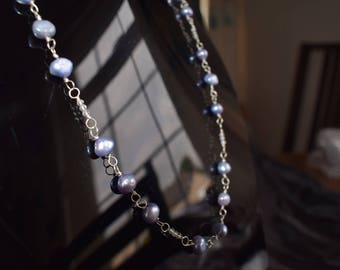 Lilac fresh water cultured pearl and white topaz necklace.