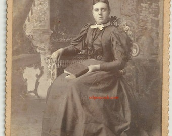 The bad book sad vintage photo frowning woman Astoria Illinois cabinet card Baird