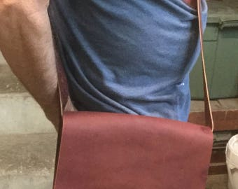 Oil tanned cowhide leather bag in a beautiful deep reddish brown, cross body over the shoulder, Native American designed webbing on strap