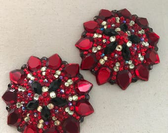 Red and black pasties with champagne accents