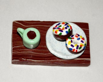 A Hand Made Coffee And Sprinkled Chocolate Donuts Polymer Clay Figurine.