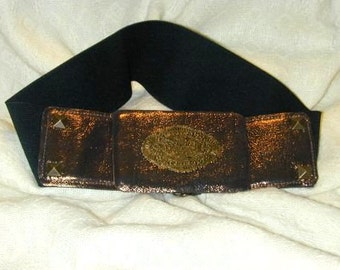 Dramatic bronzed leather buckle on wide cinch belt