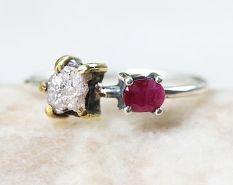 Rough diamond ring in silver bezel and brass prongs setting and oval faceted ruby on the side with sterling silver high polished band