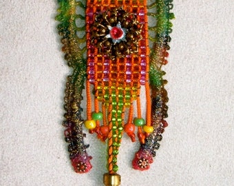 Designer pendant ethnic style, loom seed crystal from bronze flower Talala lace