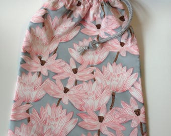 Bag pool, bag beach bag for swimsuit wet pink lotus on gray background flowers blue.