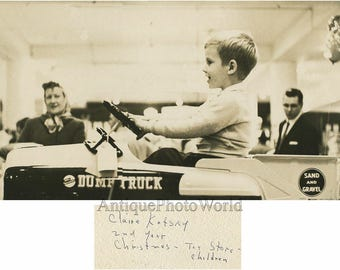 Boy in toy store playing with race car vintage art photo by Claire Kofsky