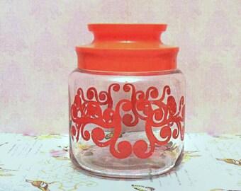 Orange design glass jar. Vintage with plastic lid