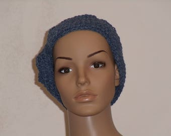 Knitted cap with an ornament on the edge in blue