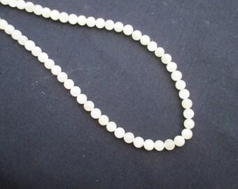 Aragonite: 15 yellow 6 mm round beads
