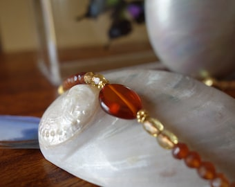 Amber gold and hessian garnet beaded necklace