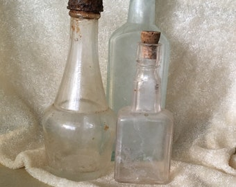 Antique Glass bottles reclaimed three