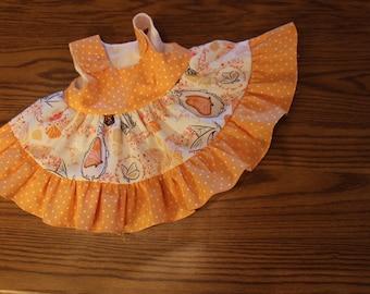Butterfly Twirl dress with orange dot bodice and ruffler