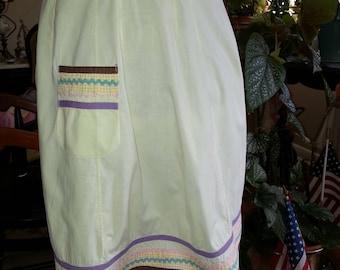 Yellow vintage half apron with rick rack trim