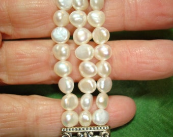 1994 Freshwater Pearl Like Triple Strand Bracelet.