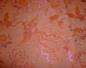 Bright coral birds fashion fabric