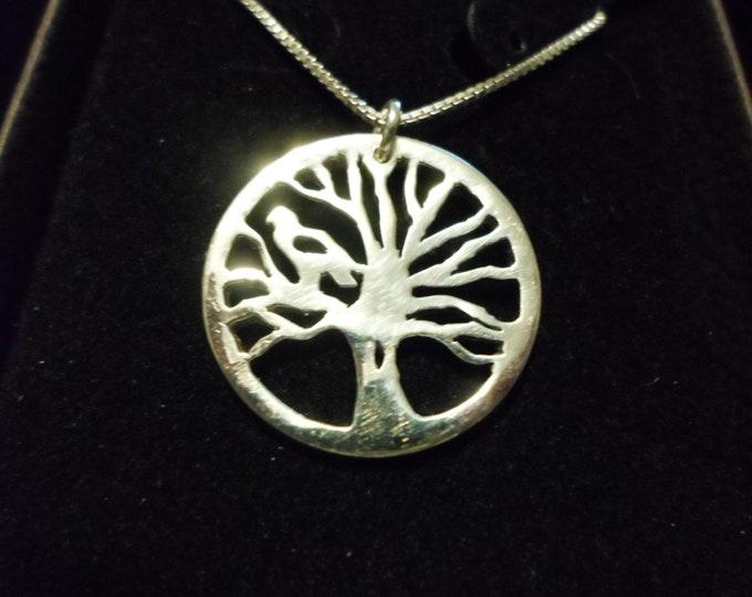 Tree of life w/hawk w/sterling silver chain quarter size
