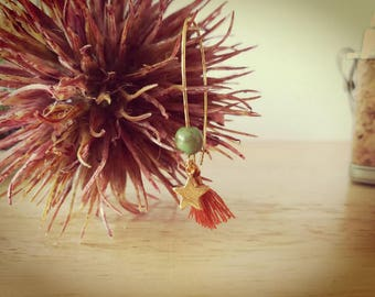 Dangling earrings with tassels