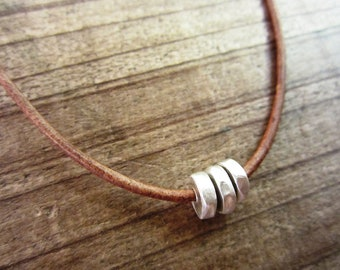 Sterling Silver and Leather Cord Necklace with Hammered Nugget Beads - mens/womens