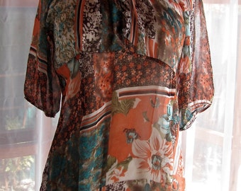 Sheer orange and turquoise blouse with front smocks