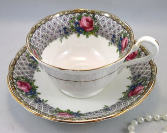 Aynsley Teacup & Saucer,Delicate Floral Design on Borders, Gold Rims, Bone English China made in 1960s