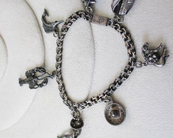 Vintage Sterling Mechoen Mexico FVM 925 Charm Bracelet with 7  sterling charms...Estate find!