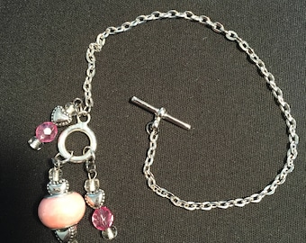 Silver chain bracelet with pink beads