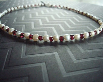 Natural shaped fresh water pearl necklace with garnet pieces