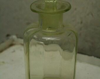 Vintage vaseline or uranium glass bottle with stop