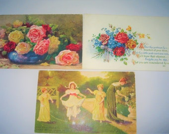 Three vintage postcards, one Tuck's oilette, one with children and one floral with a rhyme